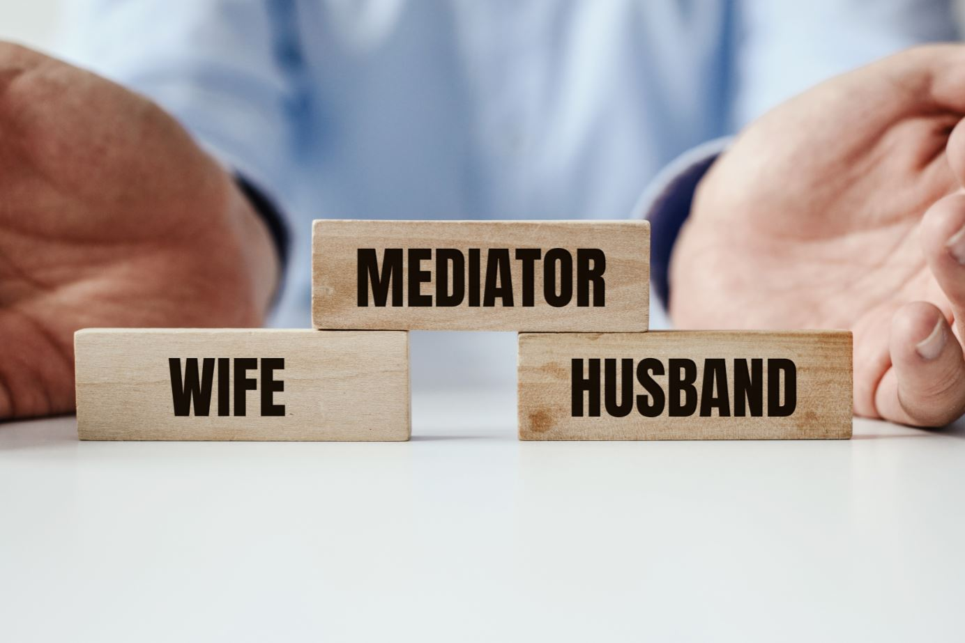 Image of wooden blocks with words relevant to Divorce Mediation.